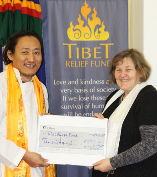 Sonam presents his donation to Tibet Relief Fund CEO Philippa Carrick