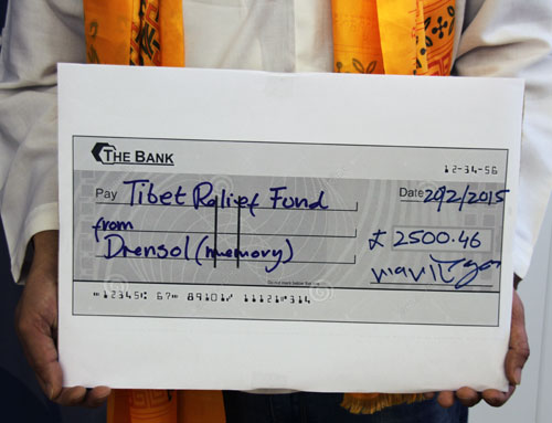 Tibetan director donates £2,500 to support elders in exile