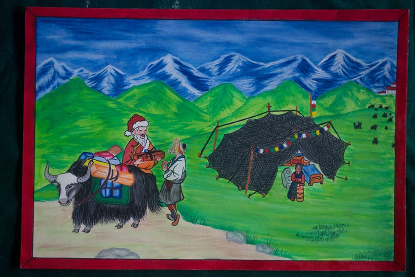 Santa's Yak - Santa has traded his reindeer for a yak to deliver prsents to nomads in this colourful image. By Tashi Sangpo