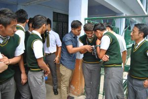 Students at Tibetan Homes Foundation trying out their new camera